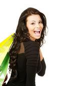 Hermosa joven con bolsas de compras — Foto de Stock