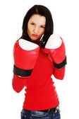 Woman wearing a pair of boxing gloves — Foto de Stock