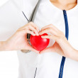 Young nurse with heart in her hand — Stock Photo #41098029