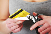 Woman has to destroy her credit card — Stock Photo
