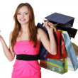 Woman with shopping bags holding credit card — Stock Photo