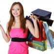 Woman with shopping bags holding credit card — Stock Photo #41418143