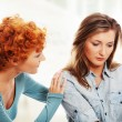 Troubled girl comforted by her friend — Stock Photo #41419465