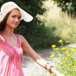 Girl in big summer hat — Stock Photo