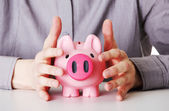 Business man protecting piggy bank  — Foto de Stock