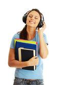 Student tjej lyssnar på musik — Stockfoto
