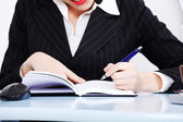 Business woman taking business notes — Stok fotoğraf