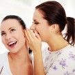 Two young girlfriends talking rummors — Stock Photo #41420673