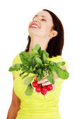 Woman holding radishes — Stock Photo