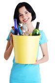 Beautiful young woman holding recycling bin — Stock Photo