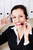 Smiling call center executive — Stockfoto