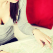 Beautiful woman taking a look at a map. — Stock Photo