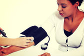 Doctor checking blood pressure of pregnant woman. — Stock Photo