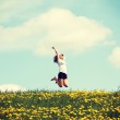 Woman jumping on blossom meadow. — Stock Photo #41532153