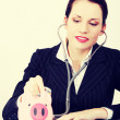 Businesswoman examining her piggy bank. — Stock Photo