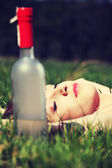 Sleeping woman on the grass — Stock Photo