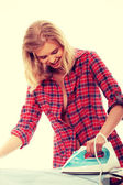 Young woman ironing — Stock Photo