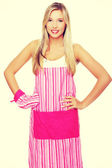 Woman wearing kitchen apron — Stock Photo