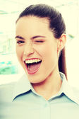 Businesswoman wink — Stock Photo