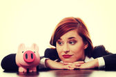 Businesswoman with piggy bank. — Stock Photo