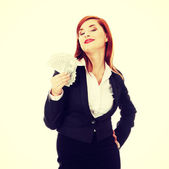 Businesswoman holding dollars — Stock Photo