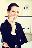 Businesswoman holding keys. — Stock Photo