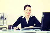 Pretty businesswoman sitting in the office. — Stock Photo
