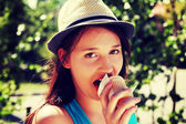 Woman in  hat eating ice cream — Stock Photo