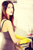 A girl washes a dish — Stock Photo