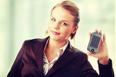 Businesswoman using a pda — Stock Photo