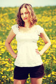 Woman standing on blossom meadow. — Stock Photo
