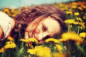 Woman is lying on meadow. — Stock Photo