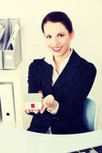 Businesswoman holding little house. — Photo