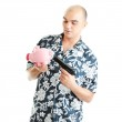 Man with gun pointing at piggy bank — Stock Photo #41793619