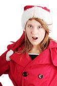 漂亮圣诞十几岁的女孩在圣诞老人帽子 — 图库照片