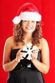 Woman wearing santa claus hat — Stock Photo