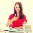 Student girl showing thumb up — Stock Photo #42258569