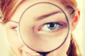 Woman with a magnifier — Stock Photo