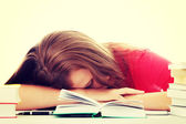 Girl sleeping at the desk — Stock Photo