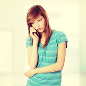 Woman getting bad news by phone — Stock Photo