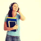 Student girl listening to the music — Stock Photo