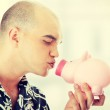 Man Holding Piggy Bank — Stock Photo #42263135