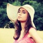 Beautiful woman on farmland — Stock Photo