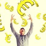 Постер, плакат: Businessman trying to catch falling down euros