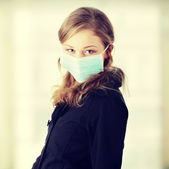 "A model in mask to prevent ""Swine Flu"" infection. — Stock Photo"