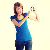 Student girl with magnifying glass — Stock Photo