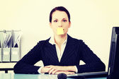 Businesswoman with post it note on her mouth. — Stock Photo