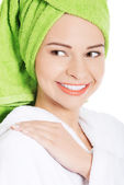 Beautiful spa woman in bathrobe. — Stock Photo