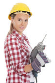 Woman with drill — Stockfoto