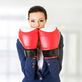 Young businesswoman with boxing gloves — Stockfoto